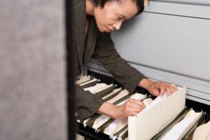business-person-looking-in-files-in-office_SFgeG2gRro-med